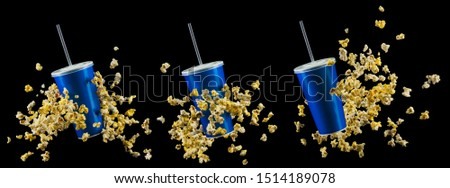 Set of blue cups and popcorn isolated on black background. Concept of refreshments in cinema or watching movies #1514189078