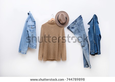 Shutterstock Set of Blue jeans and jacket , sweater clothes on hanger