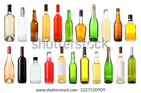 Set of bottles with different drinks on white background #1227520909