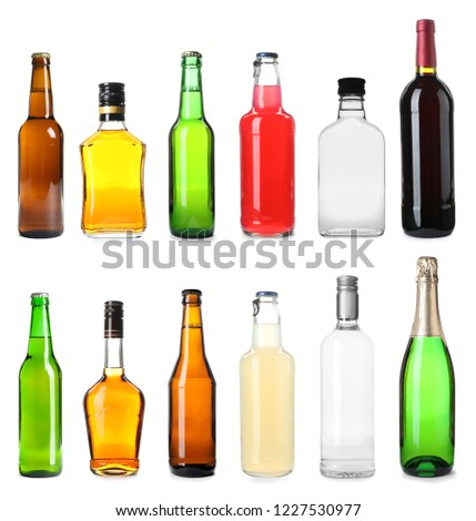 Set of bottles with different drinks on white background #1227530977