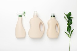 Set of bottles with mockup packaging, cleaning detergent on white background. Cleaning tools, cleanliness
