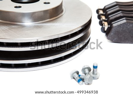 Set of brake disks and brake pads for front wheels of car, isolated on white background #499346938