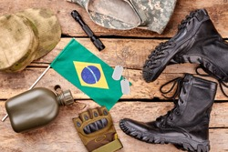 Set of brazil soldier outfit on wooden background. Brazilian flag and military accessories, top view.