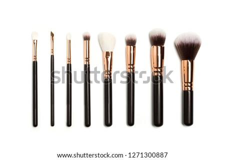 Set of brushes for powder. Powder brush set. Cosmetic brush. Cosmetic product. Powder brush over white background. Cosmetic set. Make up brushes. Make up set. Isolated brushes on white background