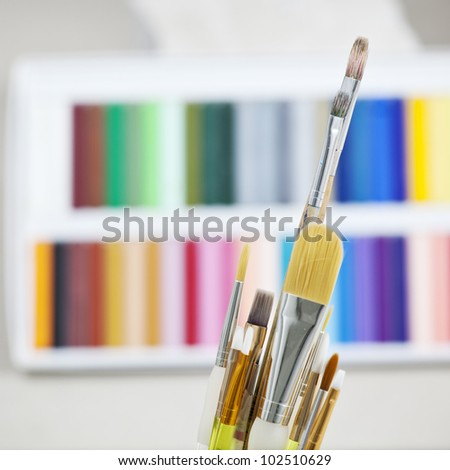 Set of brushes in a can with colorful background