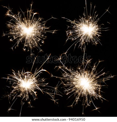 Set of burning christmas sparkler isolated on black background