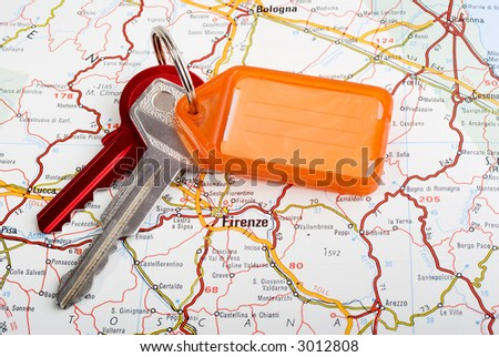 Set of car keys with key ring and tag for writing on, and map of Florence. Place names in Italian.