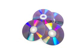 Set of cds or dvs isolated on white background, with copy space. Top view of objects with focus on the bottom. Horizontal image.