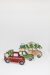 Set of christmas decorations isolated on white background.Miniature wooden car with fir tree.Chrismas story. Fairytale, miniature scenery with copy space.Christmas holiday concept.Creative postcard