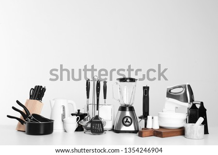 Set of clean cookware, dishes, utensils and appliances isolated on white