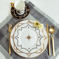 Set of clean tableware, dishes, plates, utensils on the table