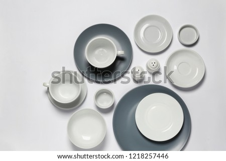 Set of clean tableware on white background #1218257446