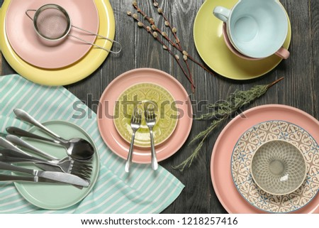 Set of clean tableware on wooden background #1218257416
