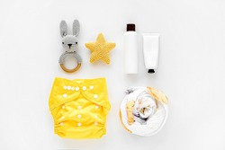 Set of cloth diaper, baby cosmetics and child stuff.  Eco friendly cloth nappies for newborn. Baby hygiene concept.  Flat lay, top view