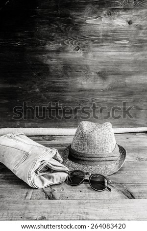 Set of clothes and various accessories for men on old wooden table