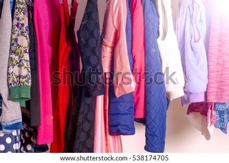 Set of clothes for kids on hangers. Shopping. Toned image. #538174705