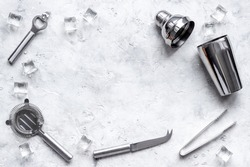 Set of cocktail drink tools and ingredients with shaker and ice. Flat lay