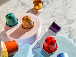 Set of coffee capsules isolated on marble background.Flat lay Disposable coffee pods . Morning dose of caffeine, energy, flavor concept. copy space