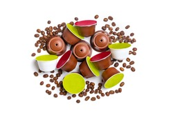 set of coffee capsules, roasted beans isolated on white background Top view Flat lay Drink obtained from dosed capsule with roasted, ground and compressed natural coffee