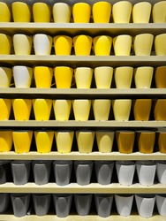 Set of coffee cups of Illuminating and Ultimate gray Pantone color of the year 2021