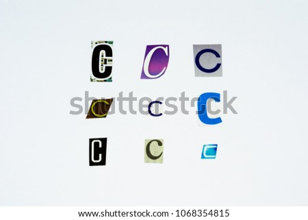 Set of collection colorful newspaper cut out letters as ornaments or design elements. Isolated on white background. Letter C.  #1068354815