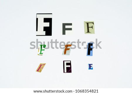 Set of collection colorful newspaper cut out letters as ornaments or design elements. Isolated on white background. Letter F.  #1068354821