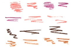 Set of color cosmetic eyebrow and lip pencil strokes on paper, beauty product sample isolated on white background. - Image