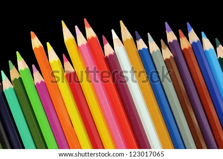 Set of color pencils isolated on a black background