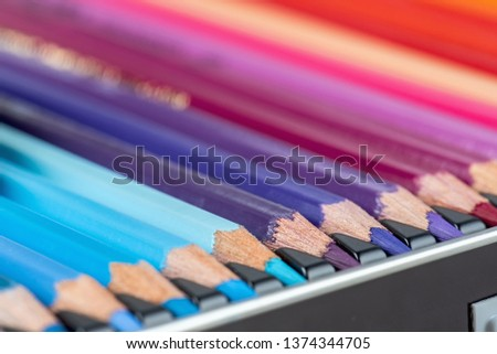 Set of colored pencils. Colored pencils for drawing different colors in box.Macro photo.