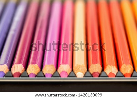 Set of colored pencils. Colored pencils for drawing different colors in box.Macro photo. #1420130099