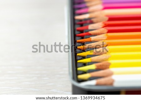 Set of colored pencils. Colored pencils for drawing different colors on a light background. #1369934675