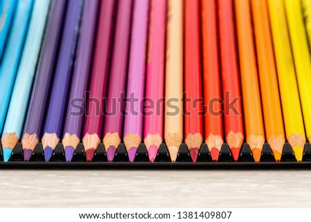 Set of colored pencils. Colored pencils for drawing different colors on a light background.