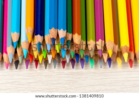 Set of colored pencils. Colored pencils for drawing different colors on a light background. #1381409810