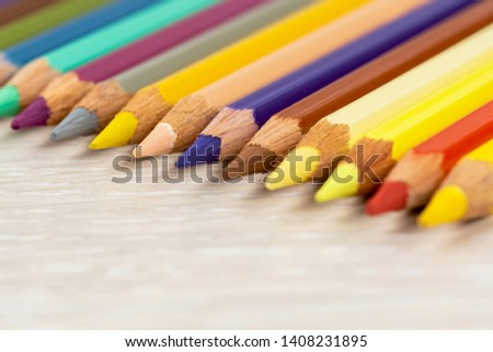 Set of colored pencils. Colored pencils for drawing different colors on a light background. #1408231895