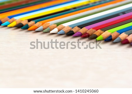 Set of colored pencils. Colored pencils for drawing different colors on a light background. #1410245060