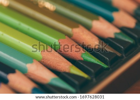 Set of colored pencils in a box. Set of artist's pencils. Wooden color pencils. The artist's drawing tool. Multi-colored pencils. Pencil point.