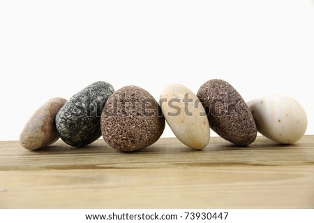 Set of colored stones on a wood board