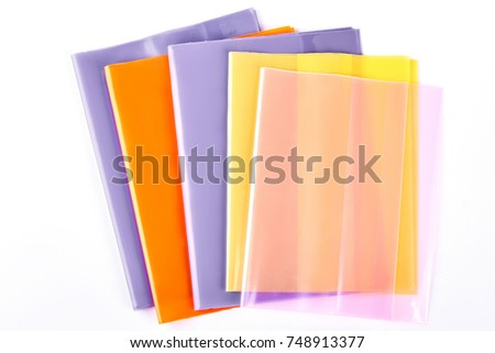 Set of colorful folders for documents. Multicolored documents files holders on white background. Office products on sale. #748913377