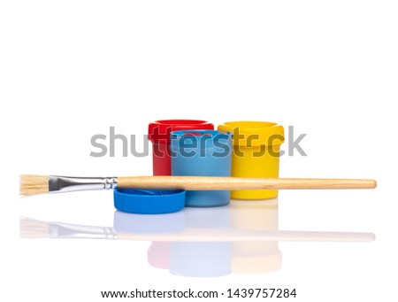Set of Colorful Gouache jars and artist brushes isolated on white background with copy space. Cans of different colors gouache paints.