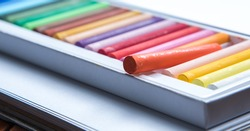 set of colorful oil pastels on white background