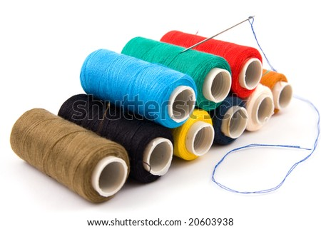 Set of colorful spools of thread isolated on white background - stock photo