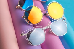 Set of colorful sunglasses on colorful background. Summer eyeglasses.Fashion collection. Sunglasses for tropical trip.Party time.
