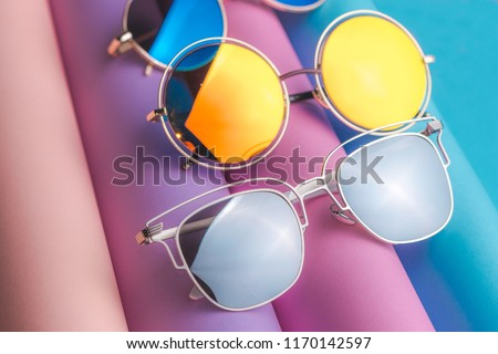 Set of colorful sunglasses on colorful background. Summer eyeglasses.Fashion collection. Sunglasses for tropical trip.Party time. #1170142597