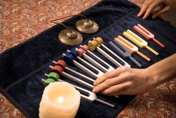 Set of colour tuning forks for sound healing with hands and bells