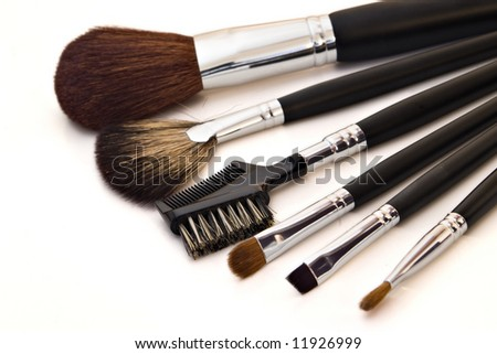 set of cosmetic brushes on white background - stock photo
