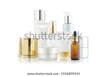 Set of cosmetic containers. Cosmetic product bottles, dispensers, droppers, jars and tubes isolated on white #1036809424