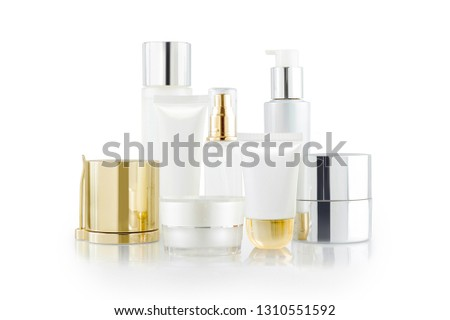 Set of cosmetic containers. Cosmetic product bottles, dispensers, jars and tubes isolated on white #1310551592