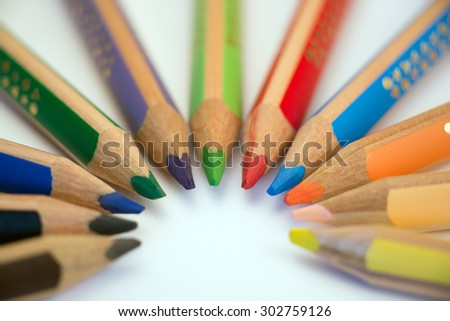 Set of crayons pointing to the center on white background