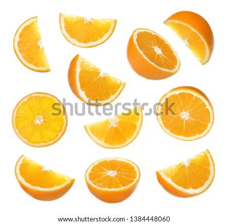 Set of cut ripe juicy oranges on white background