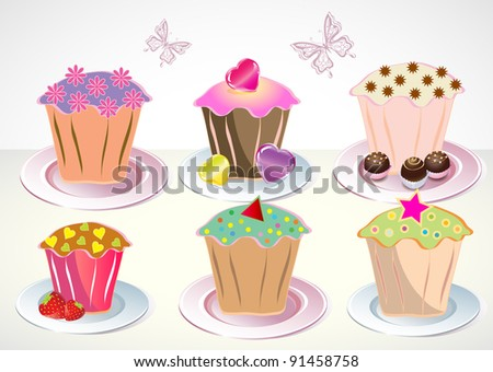Set of 6 cute cupcakes on the plates